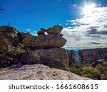 Small Rocks Balancing On Larger ...