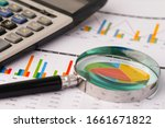 Small photo of Magnifying glass on charts graphs spreadsheet paper. Financial development, Banking Account, Statistics, Investment Analytic research data economy, Stock exchange trading, Business office concept.