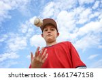 Boy Pitcher Tossing A Baseball...
