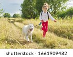 Little Girl Running With Dog In ...