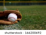 new baseball in a glove in the... | Shutterstock . vector #166200692
