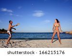 young couple playing tennis on... | Shutterstock . vector #166215176