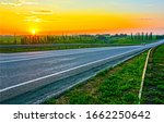 Sunset rural road landscape. Rural road sunset scene