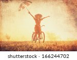 girl with umbrella on a bike in ... | Shutterstock . vector #166244702