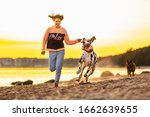 Cheerful Sporty Woman Jogging...