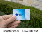 Small photo of San Antonio, TX / USA - Mar. 03, 2020: A hand holds a Sam's Club Plus Member membership card, which gives users access to Sam's Club warehouse shopping, rewards, cheap food courts, and chicken
