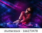 attractive young dj playing on... | Shutterstock . vector #166273478