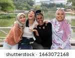 Small photo of Group of woman Malay Chinese Indian Asian outdoor green park lake nature happy laugh smile mingle
