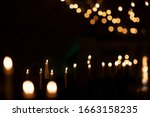 Burning Candle Lights On A Dar...