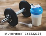 protein shake and a dumbbell on ... | Shutterstock . vector #166322195