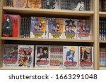 Small photo of Various japanese cartoon books for sale in a bookshop. Anime, Mange. Various mangas on display for sale. Manga comic books. Japanese culture. Japan comic Magazines. - Dubai UAE December 2019