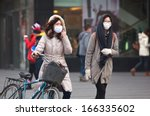 beijing dec 8  people with face ... | Shutterstock . vector #166335602