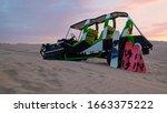 Desert Sunset With A Sand Dune...