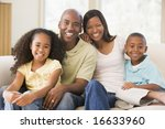 family sitting in living room... | Shutterstock . vector #16633960