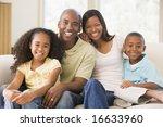 family sitting in living room...   Shutterstock . vector #16633960
