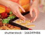 baking christmas cookies | Shutterstock . vector #166349486
