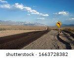Curve Ahead Road Sign Along...