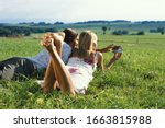 Young Couple Lying In Field...
