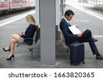 Businessman And Woman Sitting...