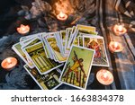 Small photo of Bangkok Thailand 28 January 2020 : Tarot card with candlelight on the darkness background for Astrology Occult Magic illustration / Magic Spiritual Horoscopes and Palm reading fortune teller concept