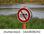No Swimming Sign By The Lake...