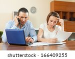 serious   man and woman looking ... | Shutterstock . vector #166409255