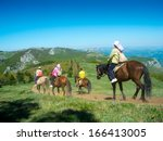 horse riders traveling in the... | Shutterstock . vector #166413005