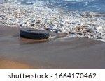 Old Car Tires On The Beach...