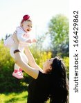 young mother having fun with...   Shutterstock . vector #166429862