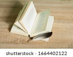 Book And Guill Pen On Wooden...