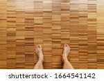 Male Bare Feet Stand On A...