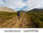 group of hikers moving on wild... | Shutterstock . vector #166549586