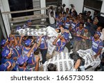 Small photo of KARACHI, PAKISTAN - DEC 09: Dead bodies of family members who died due to suffocation of poisonous gas, at Saeedabad locality of Baldia kept at Civil Hospital Morgue on December 09, 2013 in Karachi.