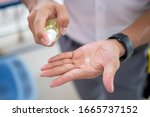 Small photo of Men's hands use hand sanitizer, hand wash gel, spray pump to clean and get rid of epidemic viruses.