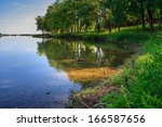 Mountain lake and forest on the embankment - stock photo