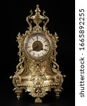 Small photo of vintage bronze watch , antique clock photo, bronze fireplace clock, eight o'clock on the dial