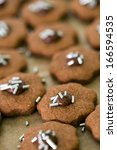chocolate cookies on a baking... | Shutterstock . vector #166594535