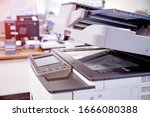 Small photo of Close-up photocopier or printer is office worker tool equipment for scanning and copy paper.