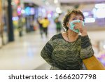 old asian woman in a mask for... | Shutterstock . vector #1666207798