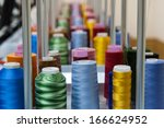 colorful reels of threads... | Shutterstock . vector #166624952