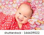an adorable baby girl wearing a ... | Shutterstock . vector #166639022