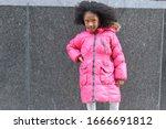 Serious Kid In Winter Coat