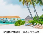 beach chair with tropical... | Shutterstock . vector #1666794625