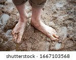 Bare Dirty Male Feet Standing...