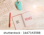 Small photo of Text sign showing Be Prepared. Conceptual photo To make ready beforehand for a specific purpose as for an event Wood desk office appliance computer equipaments chart numbers paper slot.