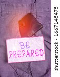 Small photo of Text sign showing Be Prepared. Conceptual photo To make ready beforehand for a specific purpose as for an event Small little wallet inside man trousers front pocket near notation paper.