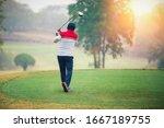 Mature Man Playing Golf On A...