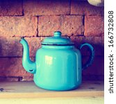 blue tea pot on the shelf and... | Shutterstock . vector #166732808