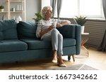 Calm Elderly Woman Sit On...