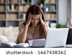 Small photo of Stressed young woman holding head in hands, feeling desperate about financial problems, dismissive notice, failed test. Depressed businesswoman shocked by bank loan rejection, domestic bills.